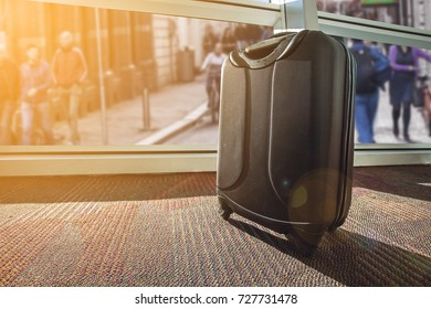 suitcase or luggage over blurred people walking in city background , Image for business and travel on vacation concept.