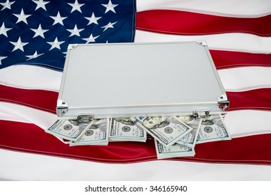 Suitcase of money with hundred dollar on flag