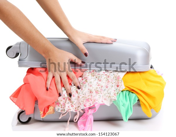 Suitcase with no neatly folded things isolated on white