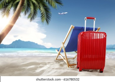 suitcase on beach and summer time