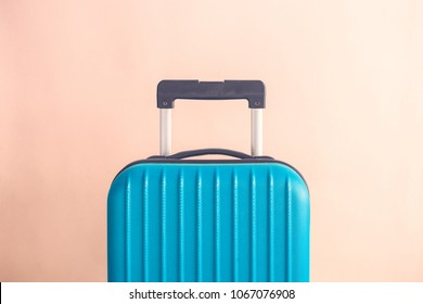 Suitcase on pastel beige background minimal creative travel concept