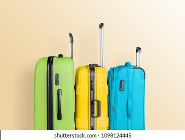 Suitcase on pastel beige background