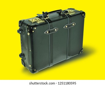 Suitcase on a yellow background. Item for transportation of things and travel.