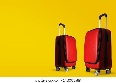 Suitcase on yellow wall, holiday background