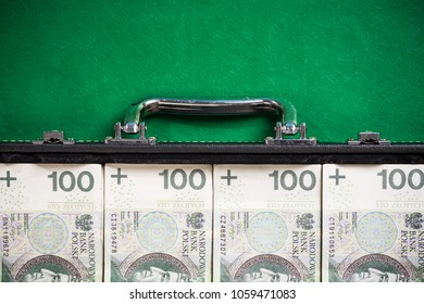 Suitcase with polish zloty , bribery and corruption concept.