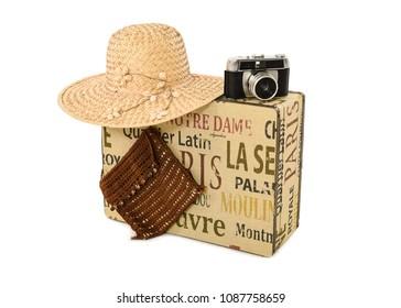 Suitcase, sunhat, handbag and vintage camera.