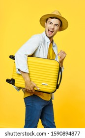 Suitcase young man travel tourism hat on his head