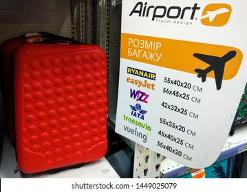 suitcases and info of plane cabin luggage allowance of ryanair,easyjet,wizz air,iata,transavia and vueling airlines on shelfe in a shop in Kiev, Ukraine, 11 July 2019.