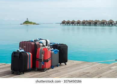 The suitcases are ready for the holidays. On a maldives island waiting suitcases for the pickup