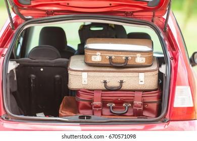 Suitcases in the trunk of a car
