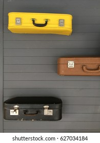 Suitcases in the wall
