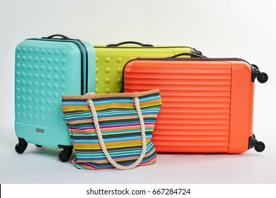 Suitcases and woman handbag. Colorful luggage and positive emotions.