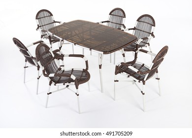 Suite of wicker furniture made of synthetic fibre on isolated background