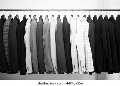 Suits jacket hanging stacked on hanger,black and white