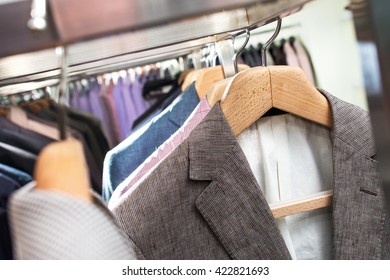 suits on hangers in store