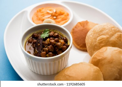 Suji/Sooji Halwa Puri or Shira Poori breakfast, served in a plate and bowl. selective focus