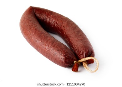 Sujuk (sucuk), a dry spicy sausage isolated on white background