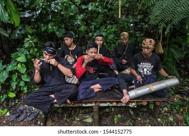 Sukabumi,west java/Indonesia - February 24, 2019 : Musician playing cemplung a traditional sundanese bamboo instruments in Situ gunung of  gede pangrango mount national park