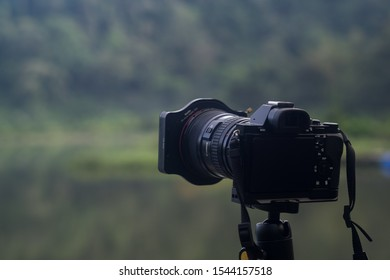 Sukabumi,west java/Indonesia - February 24, 2019 : a camera stand on a tripod taking picture of Situ gunung in gede pangrango mount national park.
