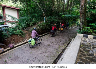 Sukabumi,west java/Indonesia - February 24, 2019 : Domestic tourists with bikes visit and enjoy Situ gunung suspension bridge in gede pangrango mount national park