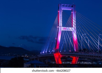 The Sukarno Bridge over the harbor in Manado by night, North Sulawesi, Indonesia