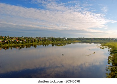 Sukhona river and Totma city on its opposite bank, Vologodskaya region, Russia