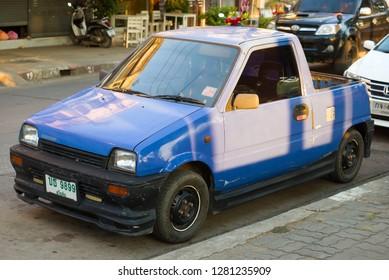 SUKHOTAI, THAILAND - DECEMBER 25, 2018: A little pickup of Daihatsu Mira on a city street