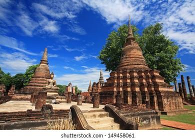 Sukhothai historical park - ancient pagodas against blue sky at wat Mahathat, Thailand
