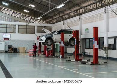 SUKHOTHAI - JUNE 15:mechanic repairing car at Mitsubishi Motor Service station on June 15, 2019 in Sukhothai, Thailand.