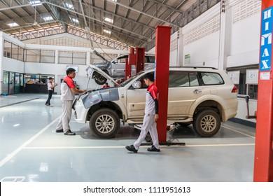 SUKHOTHAI - MAY 26:mechanic repairing car at MItsubishi Motor Service station on May 26, 2018 in Sukhothai, Thailand.