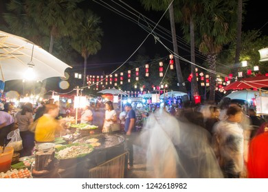 Sukhothai - November 24 ,2018: Th enight market in light color Sukhothai Co Lamplighter Loy Kratong Festival at The Sukhothai Historical Park covers the ruins of Sukhothai, Thailand