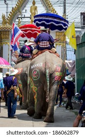 SUKHOTHAI, THAILAND - April 7 : Unidentified people in tradition of the Sri Satchanalai district for ordaining a whole group of new monks with elephants on April 7, 2014 in Sukhothai, Thailand.