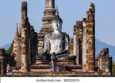 Sukhothai, Thailand - February 16, 2016:  Buddha statues at Wat Mahathat ancient capital of Sukhothai, Thailand. Sukhothai Historical Park is the UNESCO world heritage