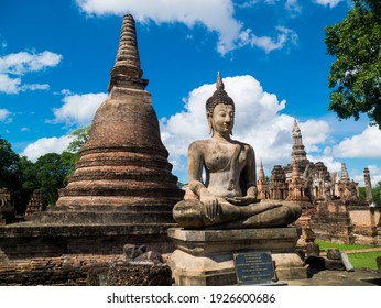 SUKHOTHAI, THAILAND - November 1, 2020 : Ancient pagodas, Buddha statue and ruins of building are all in the Sukhothai Historical Park, famous tourist attraction in Sukhothai province, Thailand.