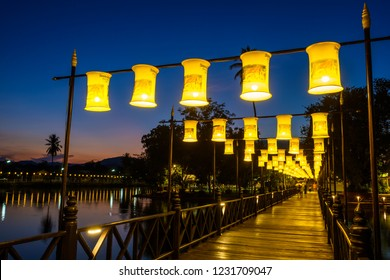 Sukhothai, Thailand - November 14, 2018 : The wood bridge at Wat TraPhang Thong temple is decorated with many fabric lamps for Loi Krathong festival.
