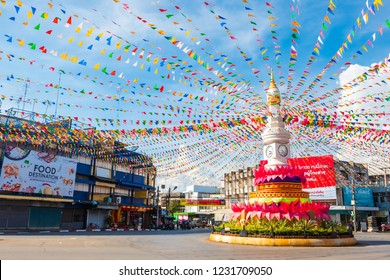 Sukhothai, Thailand - November 14, 2018 : The clock tower in downtown of Sukhothai is decorated by colorful fabric and buntings for Loi Krathong festival.