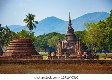 Sukhothai Wat Mahathat Buddha statues at Wat Mahathat ancient capital of Sukhothai, Thailand. Sukhothai Historical Park is the UNESCO world heritage