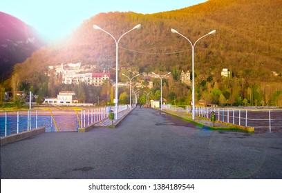 Sukhum, Abkhazia, - 03 January, 2013: Lake Ritsa in the mountains of Abkhazia. Houses on the mountain in Abkhazia