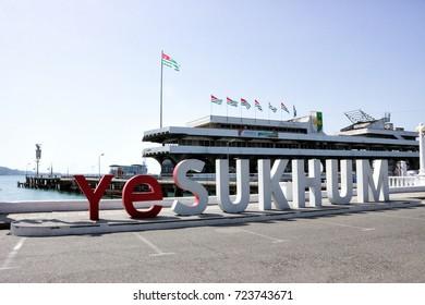 "Sukhum, Abkhazia - June 28, 2017: The inscription ""I love Sukhum"" on the shore of the sea pier."