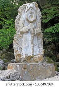 Sukhumi, Georgia - August 21, 2017: statue of old man on road to lake Ritsa in Abkhazia