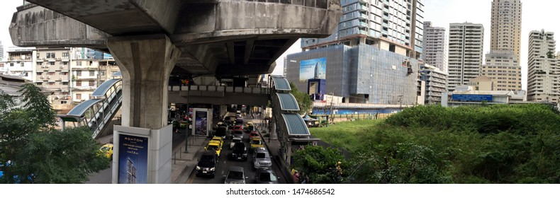 Sukhumvit, Bangkok, Thailand-December 2 2017: Panoramic of streets below BTS Skytrain train concrete structure in Sukhumvit area, Bangkok. Daytime, panoramic stitch.