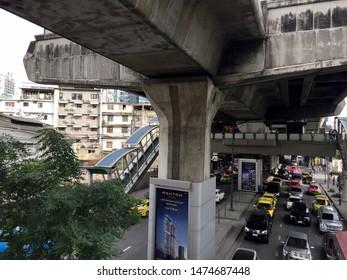 Sukhumvit, Bangkok, Thailand-December 2, 2017: Streets below BTS Skytrain train concrete structure in Sukhumvit area, Bangkok. Daytime.
