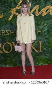 Suki Waterhouse arrives at The Fashion Awards 2018 at the Royal Albert Hall on December 10, 2018 in London, England.