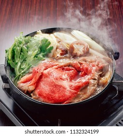 Sukiyaki is a popular one-pot meal. The main ingredient is thin sliced beef, and it is simmered in skillet with sukiyaki sauce and lots of vegetables.