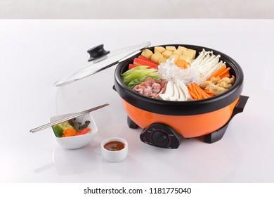Sukiyaki pot with vegetable and pork isolated on white background
