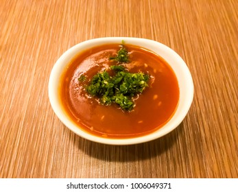 Sukiyaki sauce with chilli in white bowl on wood table