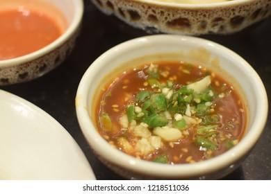Sukiyaki sauce/Sukiyaki beef in raw egg/Dipping sauce using sesame oil/ chili sauce as the main ingredient/Famous for China,Japan, Thailand and around the world.