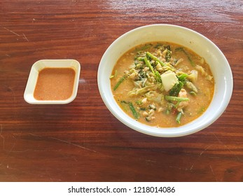 Sukiyaki (Thai Suki) in broth Mixed seafood with vermicelli,vegetables, on wooden background. Thai food,
