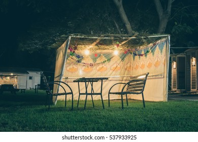 Sukkah decorated with printed pattern and hebrew text of blessing: Grant peace everywhere goodness and blessing, Grace, lovingkindness and mercy to us and unto all Israel, Your people. Toned image
