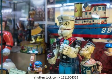 Suksasom museum at Phutthamonthon Sai 2, Bangkok, Thailand, 24 Sep, 2018 : Closed up antique tin Popeye toy model.